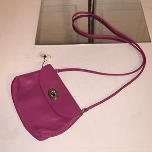Fossil cross body fuchsia colored bag
